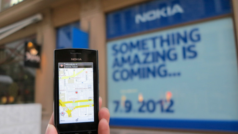 Will history repeat? A man holds a Nokia 500 series phone in front of a Nokia storefront in Helsinki in 2012.