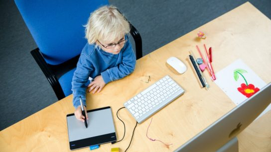 A youngster tries his hand at a digital drawing board. Finns have been found to take advantage of their human capital potential at all stages of life.
