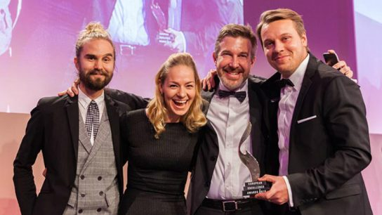 (l to r) Jari Lähdevuori, Elli Tuominen and Tommi Opas from Kurio received the award together with Jukka Peltoniemi from Neste at the Ritz-Carlton, Berlin.