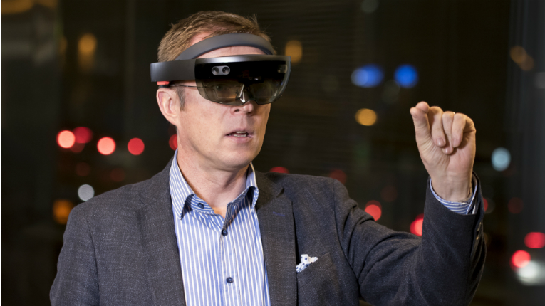 Jari Kotola using the Hololens to select unique QR codes generated by Magic Add Ltd.
