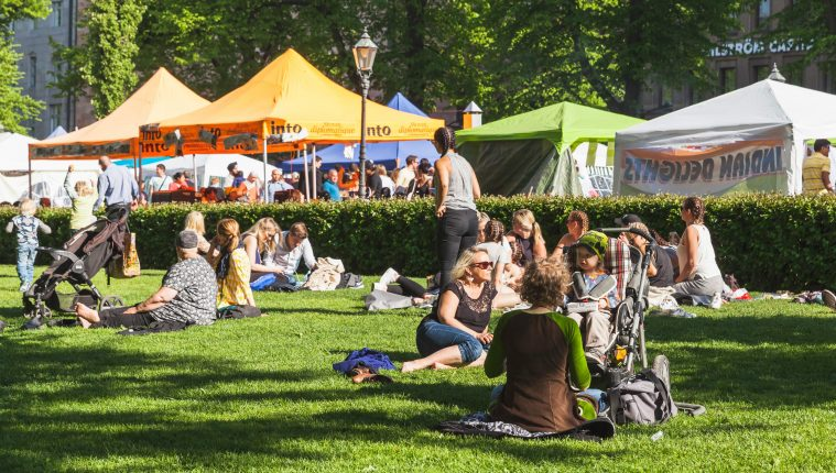 People enjoying the sunshine in Helsinki's Esplanade during Restaurant Day. Finland has been ranked highly in the index over the past five years.