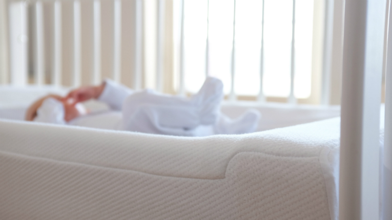 A motor in the LullaMe mattress gently tightens and loosens the top fabric creating a slow up and down rocking movement.