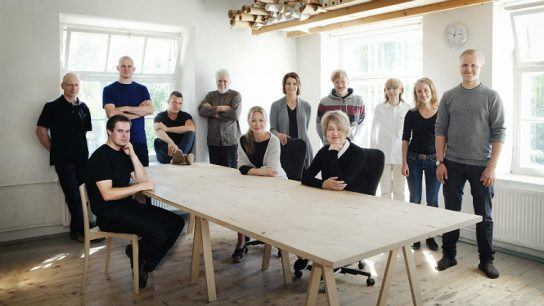 Johanna Vuorio (seated, centre) wants to ensure traditional woodworking skills stay alive in Finland and provides apprenticeships for young cabinet makers at Nikari.