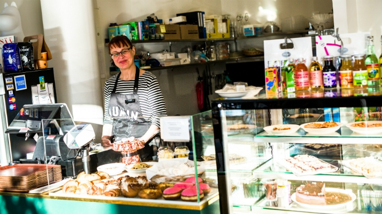 Taina Hassinen serves customers at one of the Mumin Kaffes in central Helsinki.