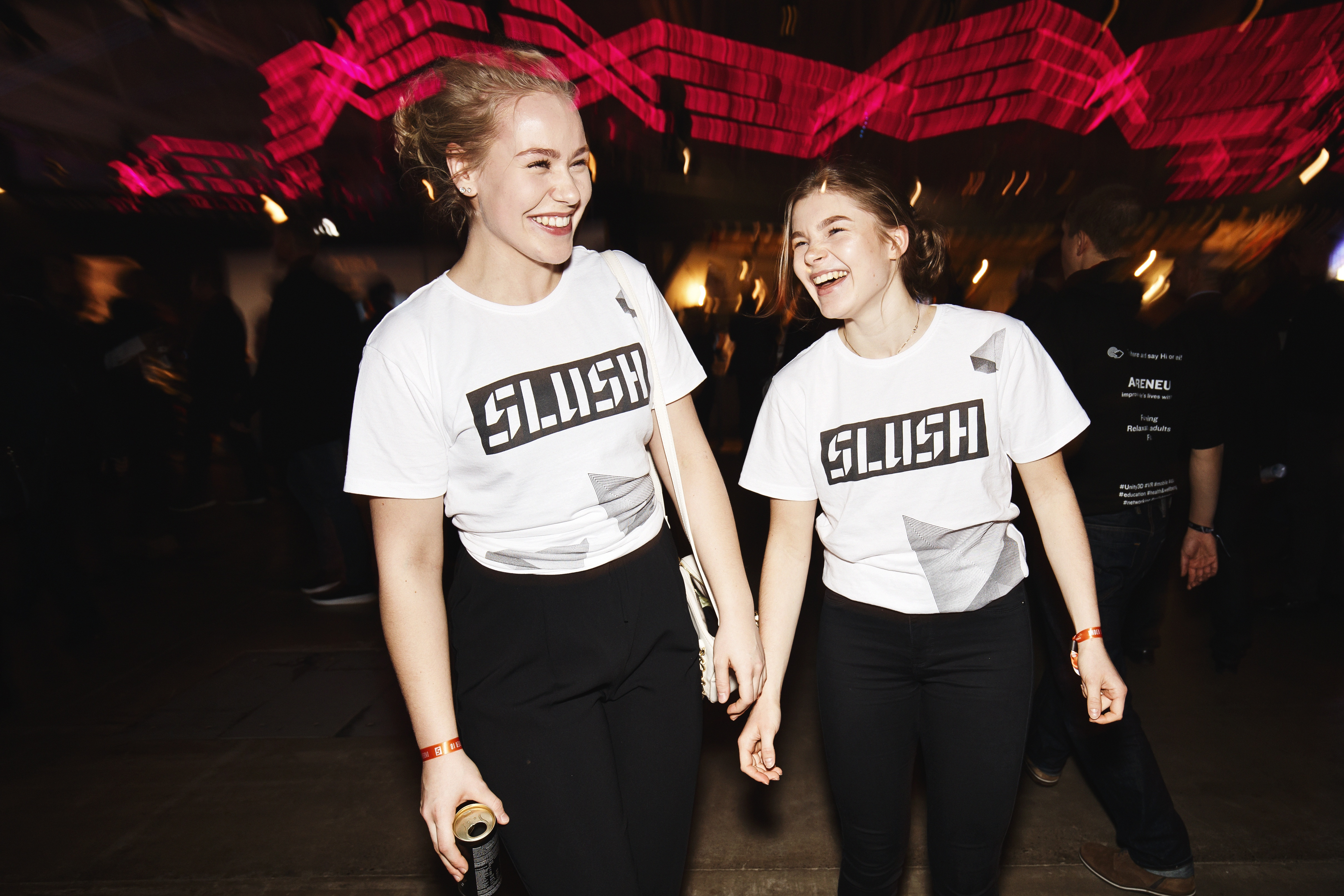"Slush owes a lot to its volunteers. Kaisa Kuitunen and Aava Harju work at the cloakroom and the coffee and water station as part of their school course. Their studies at a Helsinki Upper Secondary School focus on international business. ""We're learning a lot here and seeing all sorts of relevant things,"" they say."