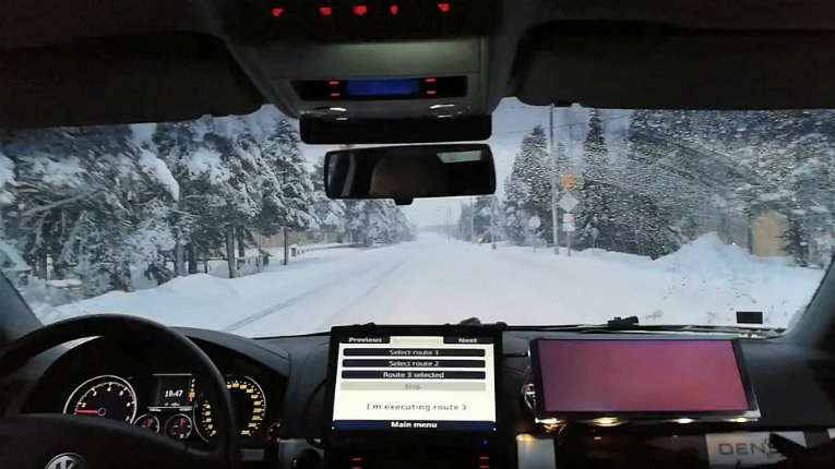 No hands as VTT's automated car Martti drives itself on the snow-covered Aurora E8 road.