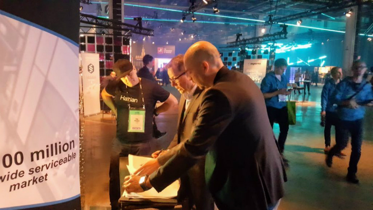 Haltian and Inventure management oversee the closing of the significant funding round at the Slush 2018 startup event in Helsinki, Finland.
