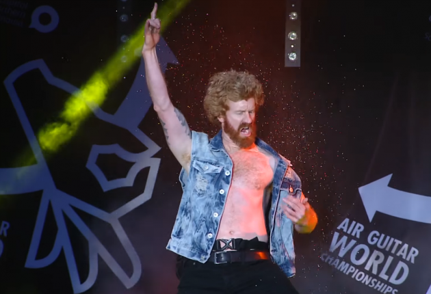 "The runner-up of last year's Air Guitar World Championships in Finland, Alexander ""The Jinja Assassin"" Roberts is an Australian high school drama teacher by day. (Photo: YouTube/Screenshot)"