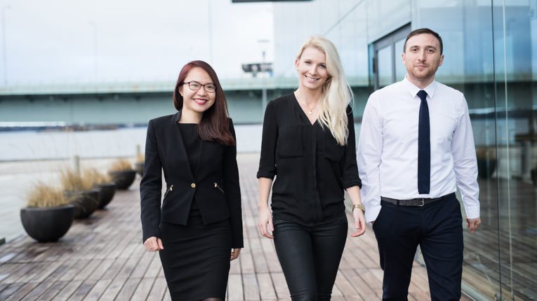 Three people from the growing BrandBastion team (left to right): Linh Truong/project manager, Jenny Wolfram/CEO, Bogdan Dinca/head of technology.