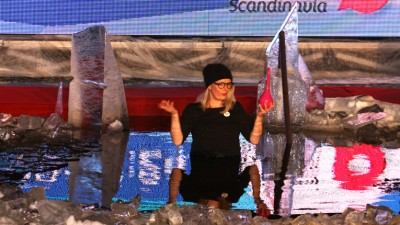 CEO Miia Liesegang braved the elements to present Belightful's designer butterfly feeder.