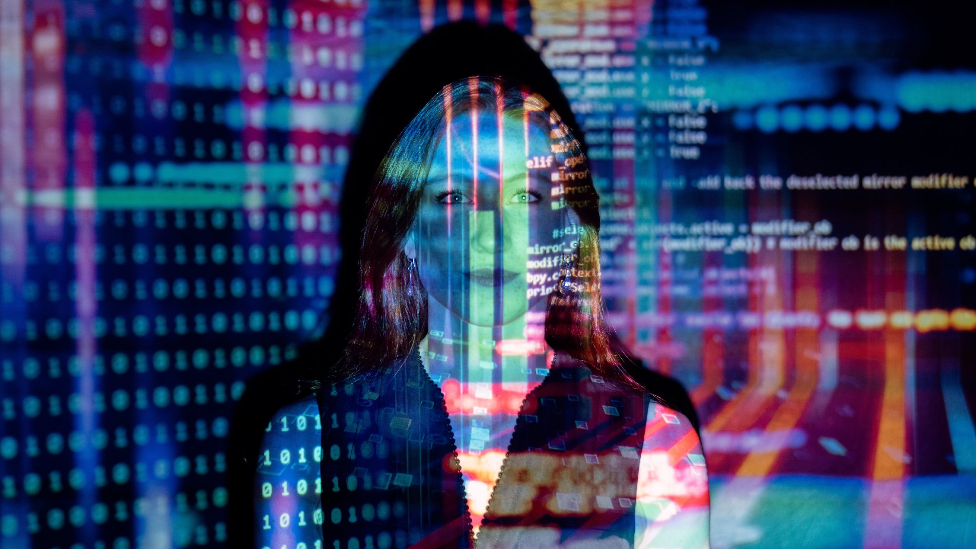 Code projected over woman