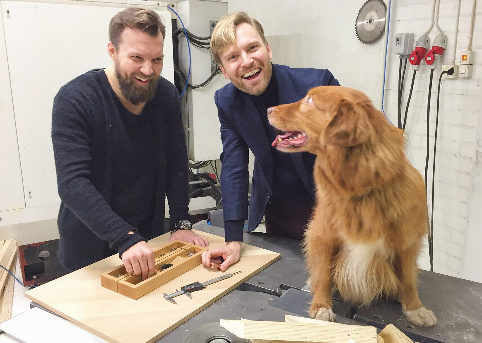 Man's best friend is also chummy with these two Helsinki-based businessmen.