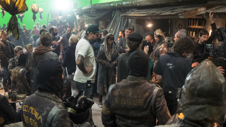 Director Timo Vuorensola instructs The Coming Race actors on the Moon Market set.