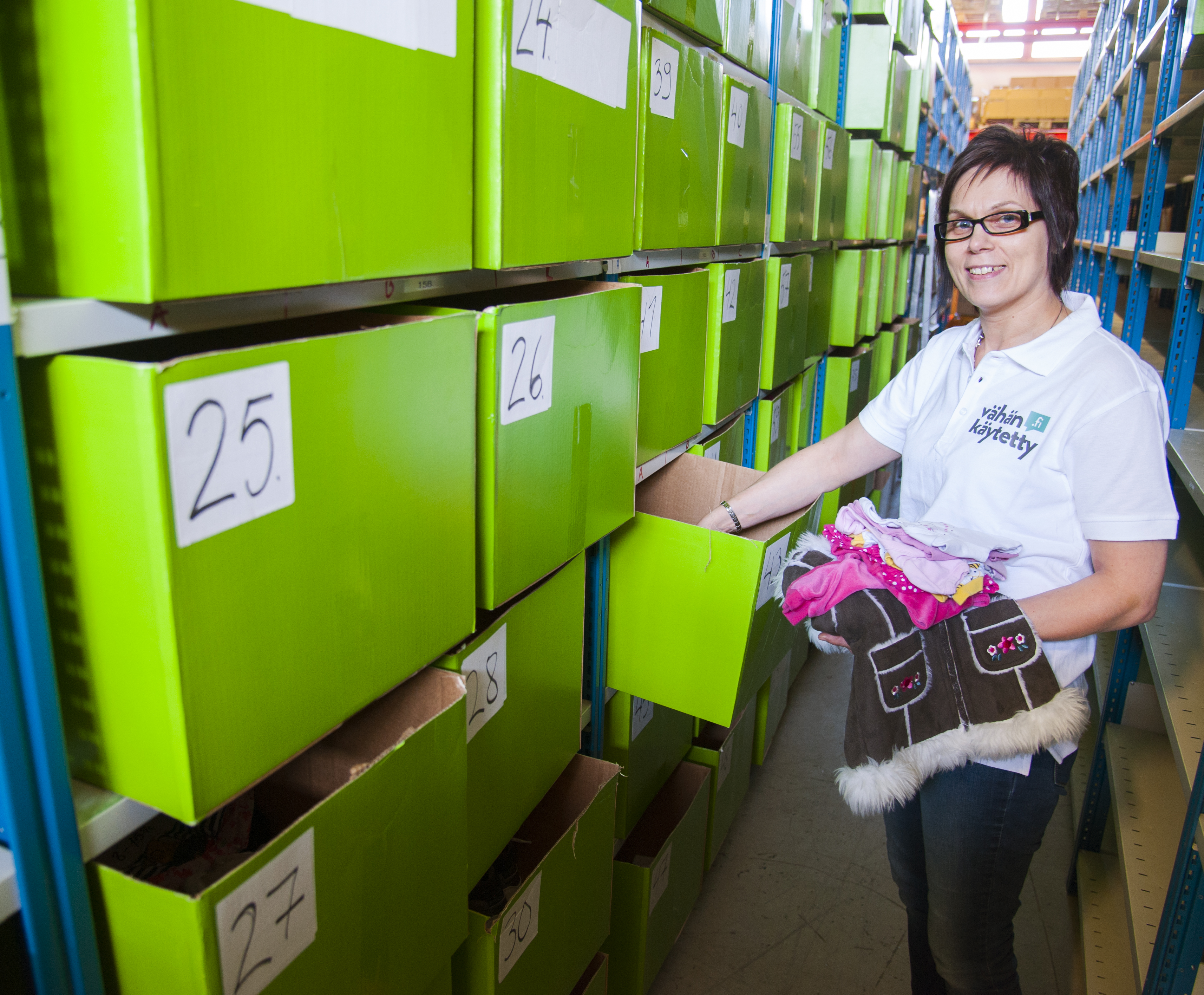 Tuula Karsikas at the Netflea storage in Oulu. Once a product arrives, it takes about 30 seconds for it to be placed on the right shelf.
