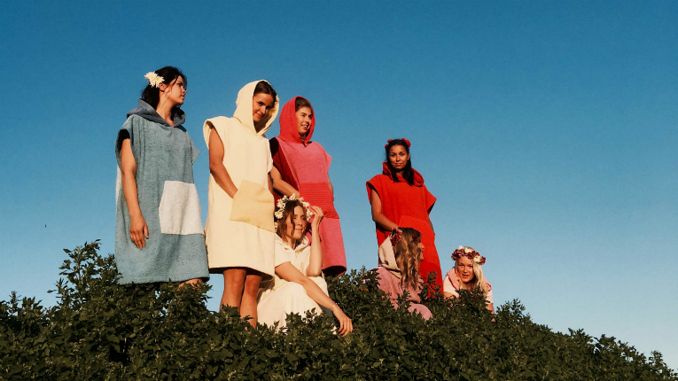 The soft and colourful towel takes its wearer, at least mentally, to the lakeside of Finland.