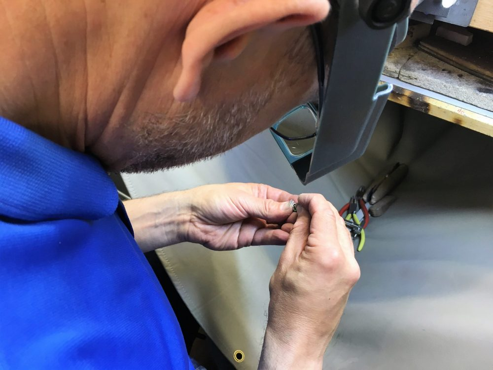 man working with handcrafted jewellery