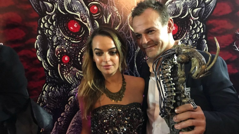 Director Jesse Haaja and his girlfriend, Australian actress Bianca Bradey pose with the award at the Feratum Film Festival.