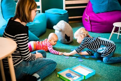 Suvi Kataja and her children Ella and Anni make use of Mumin Kaffe's play area.