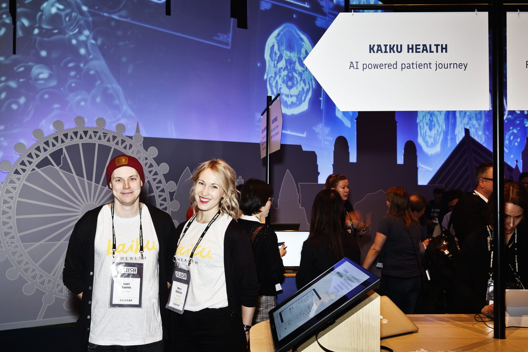 """Lauri Luotola (left) and Noora Kykkänen from Kaiku Health tell that the company is attending Slush particularly to attract new team members. Kaiku Health has doubled its workforce in 12 months, and next year they want to grow from 20 to 40. """"Here's where we find brilliant coders and big data experts."""""""