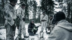 """The story is flavoured with broad Finnish dialects that highlight the country's diversity. """"In one sense this has been a central point of strength for Finland – we have united when needed,"""" says Louhimies (sitting on the ground)."""