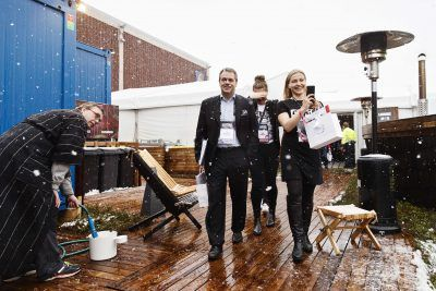 Helsinki mayor Jan Vapaavuori (in suit, left) and Slush CEO Marianne Vikkula brave the elements.