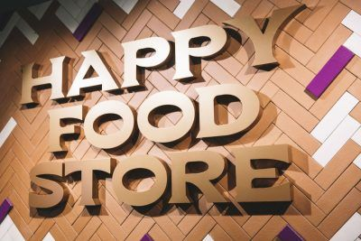 The store's international name refers to how it wants everyone to feel: happy.