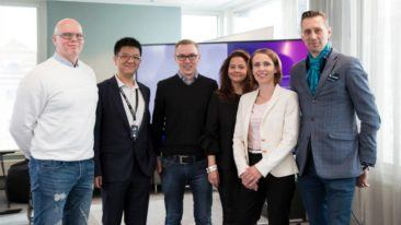 Stronger together. Eficode's owner and CEO Risto Virkkala stands next to Bocap founder Julianna Borsos in the middle, along with management from both firms.