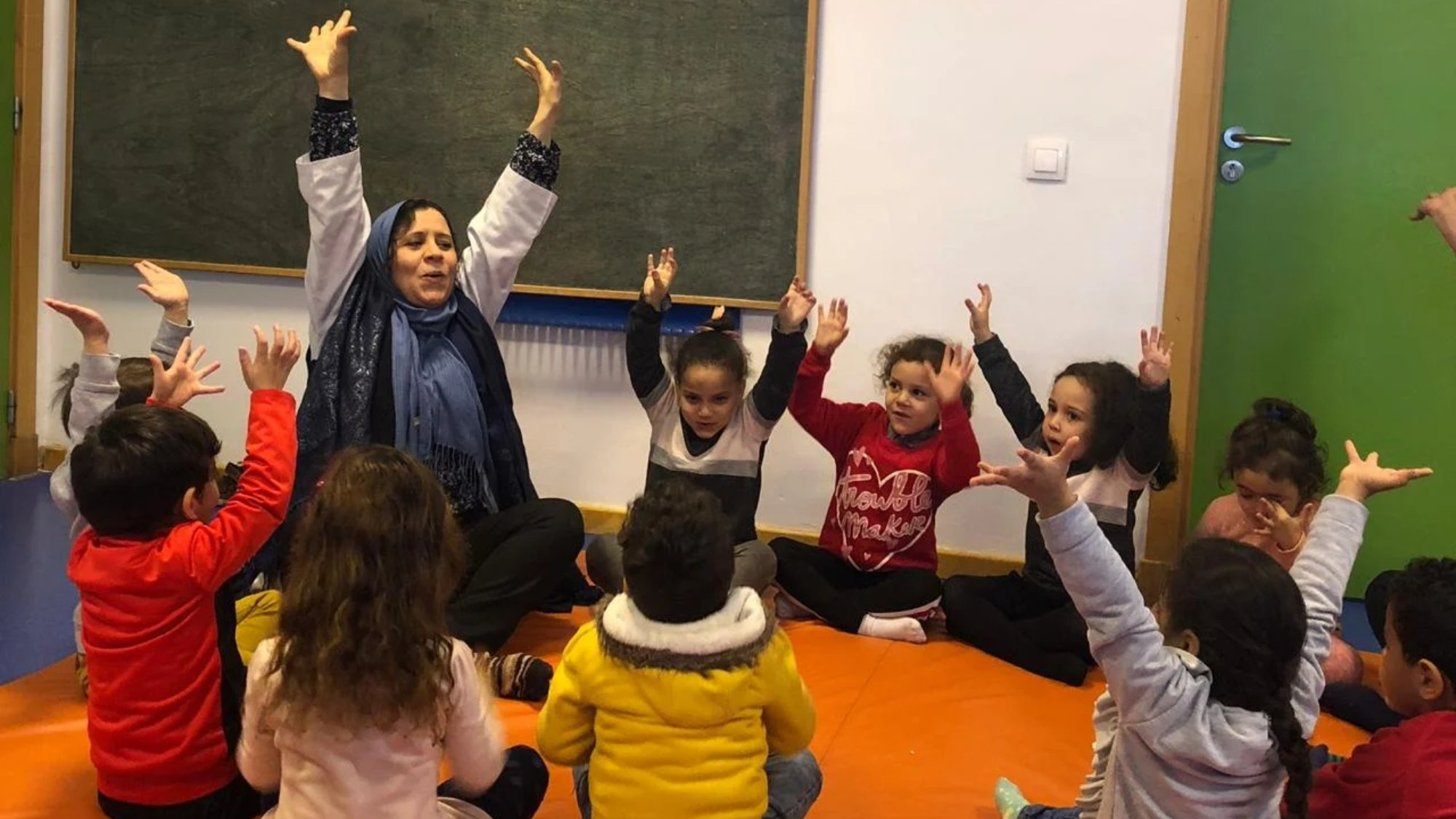 Children in a class learning through play