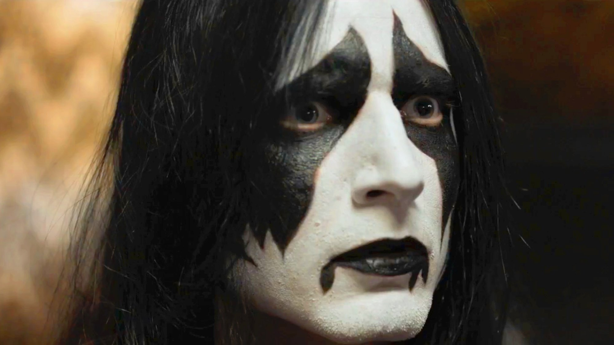 screen shot of a movie. Actor wearing corpse paint