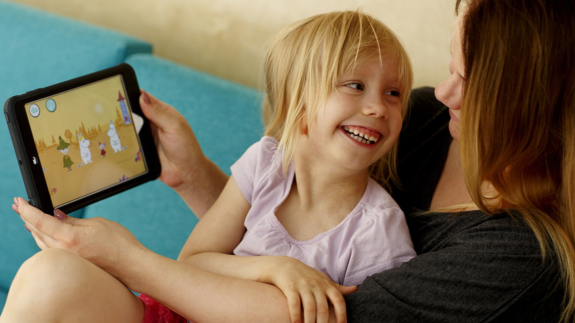 Mother and child using tablet to learn new languages