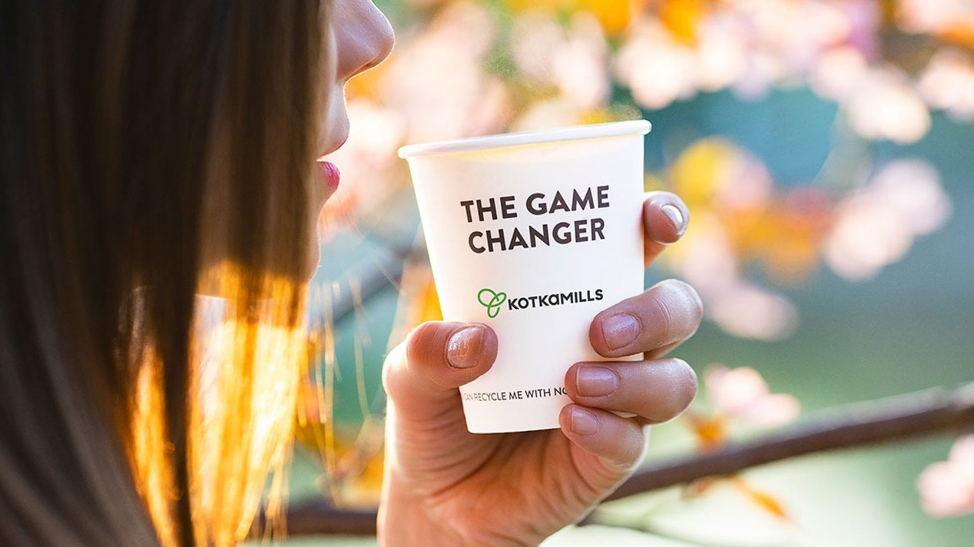 woman holding a Disposable cup