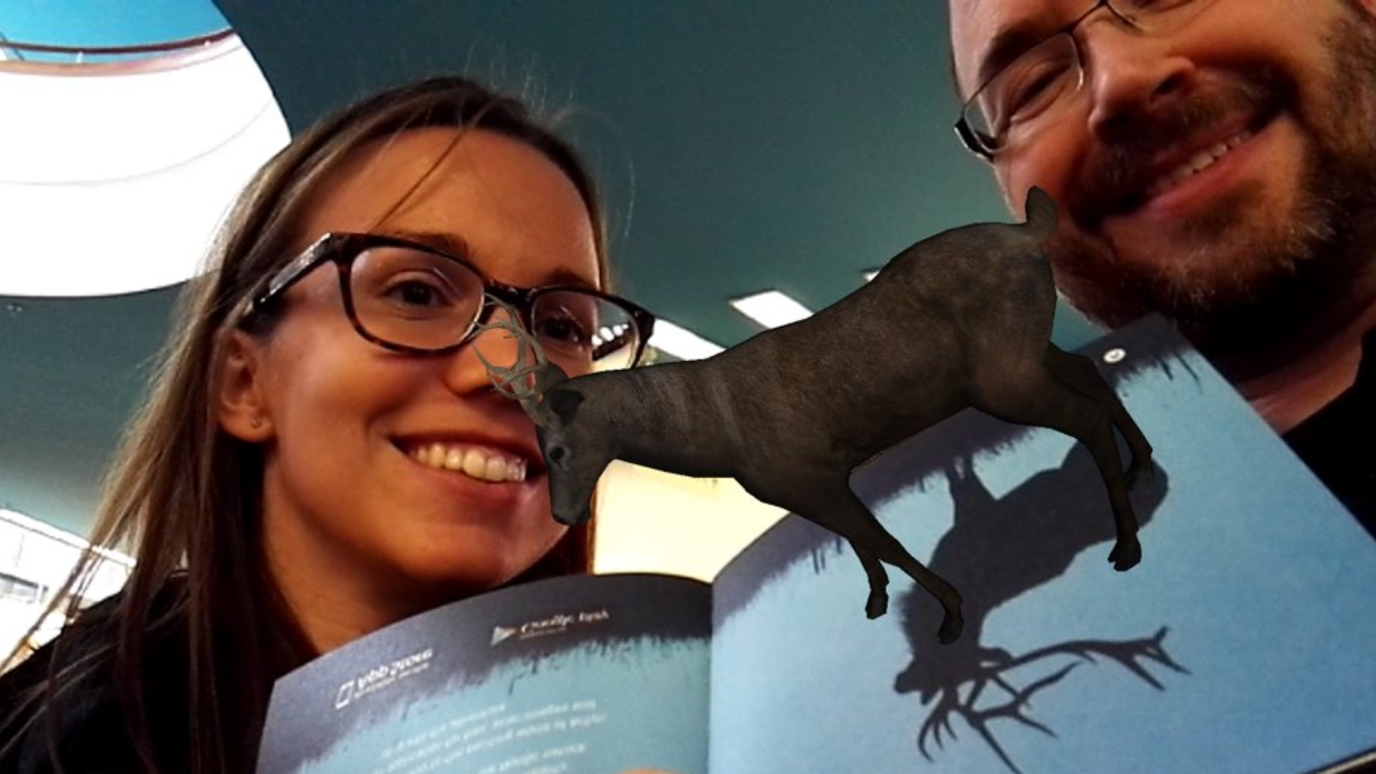 two people and an augmented moose