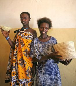 The basket weaving craft is passed down from one generation to another.