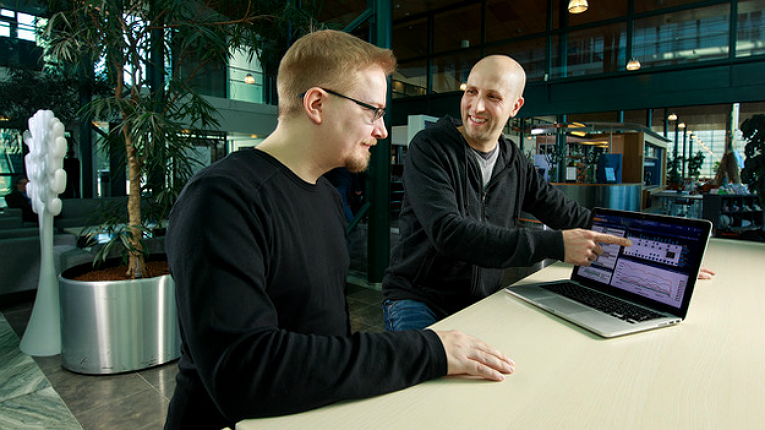 Arctic Security's head of R&D, Teemu Vaskivuo (right), and solutions architect, Juha Haaga, review the current state of cyber crime using Arctic Hub's dashboard.