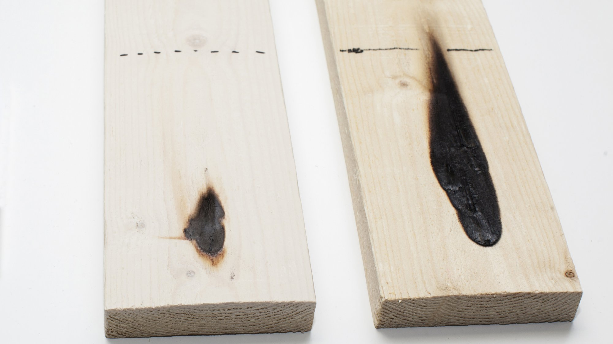 pieces of wood after flame testing