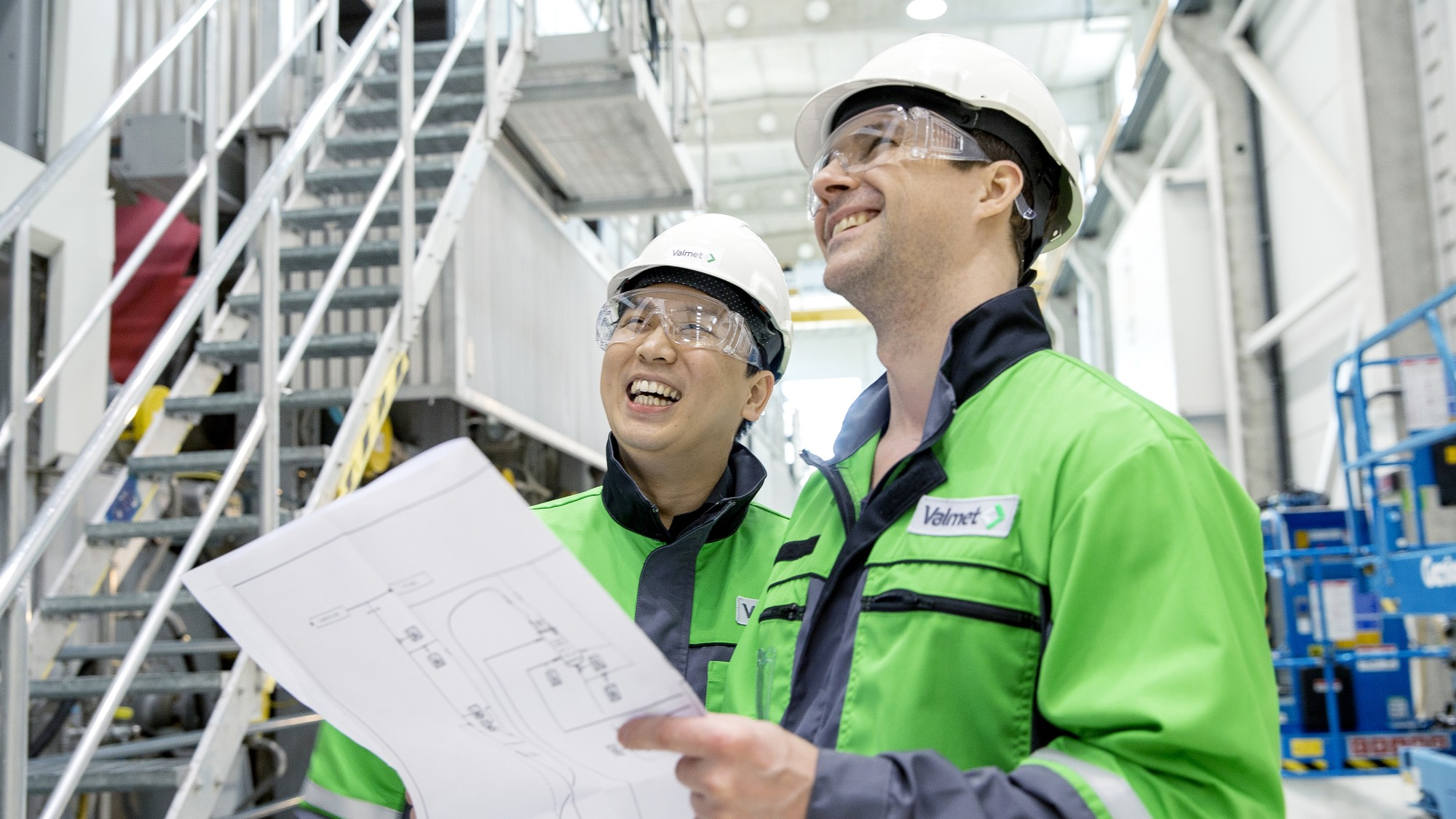 Valmet workers looking at a blueprint