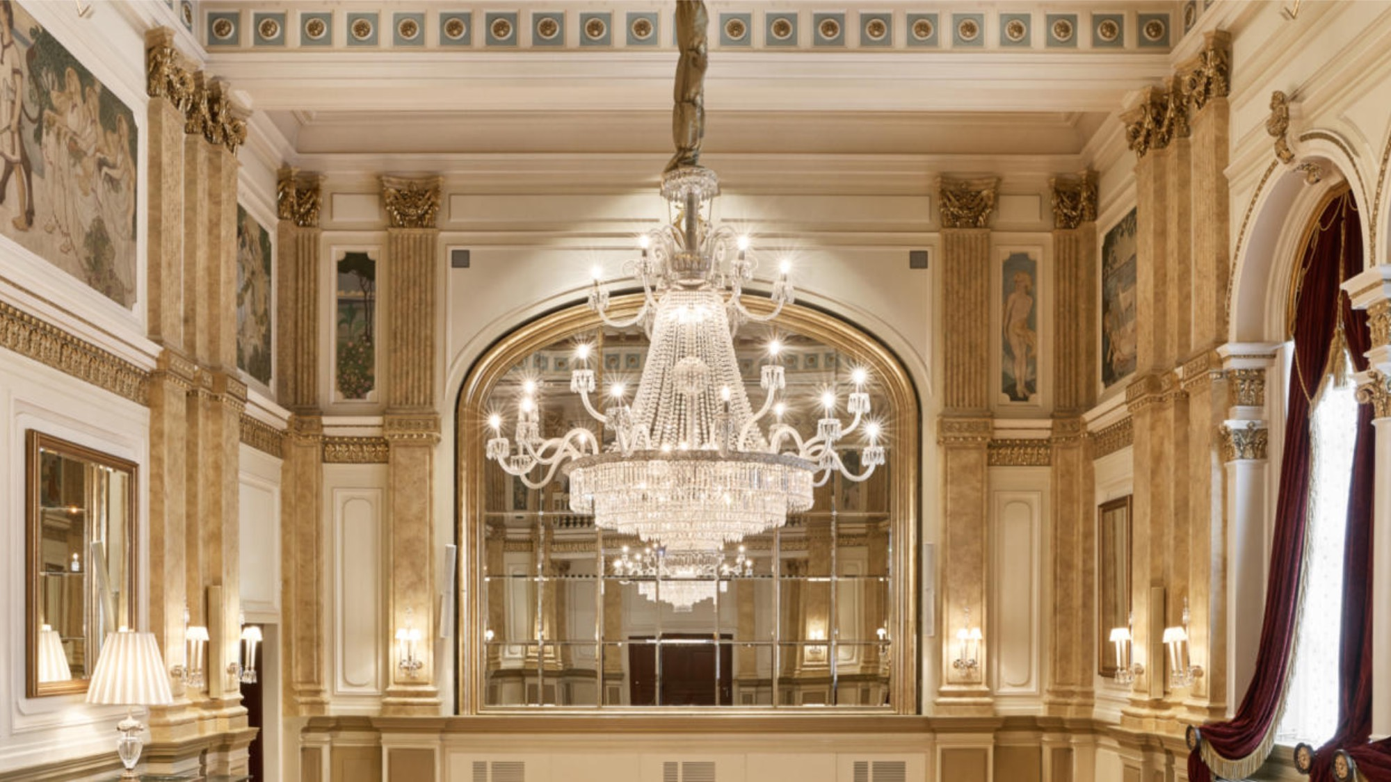 A luxury hotel hall with a crystal chandelier
