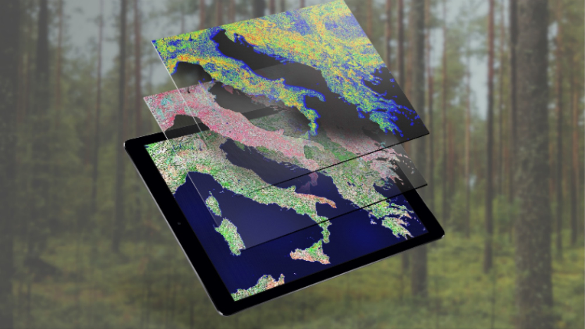 An tablet with space imagery set against a forest background