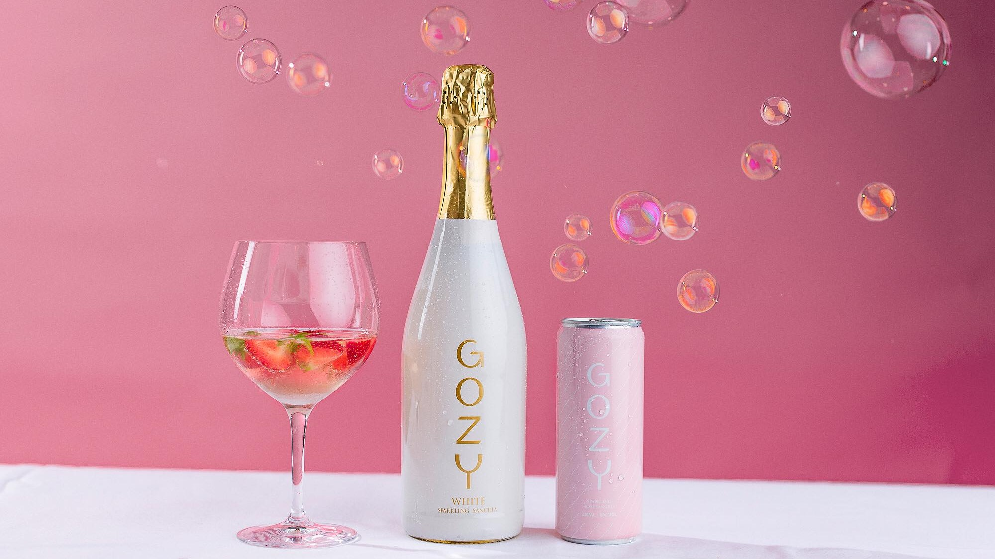 A bottle, glass and bubbles