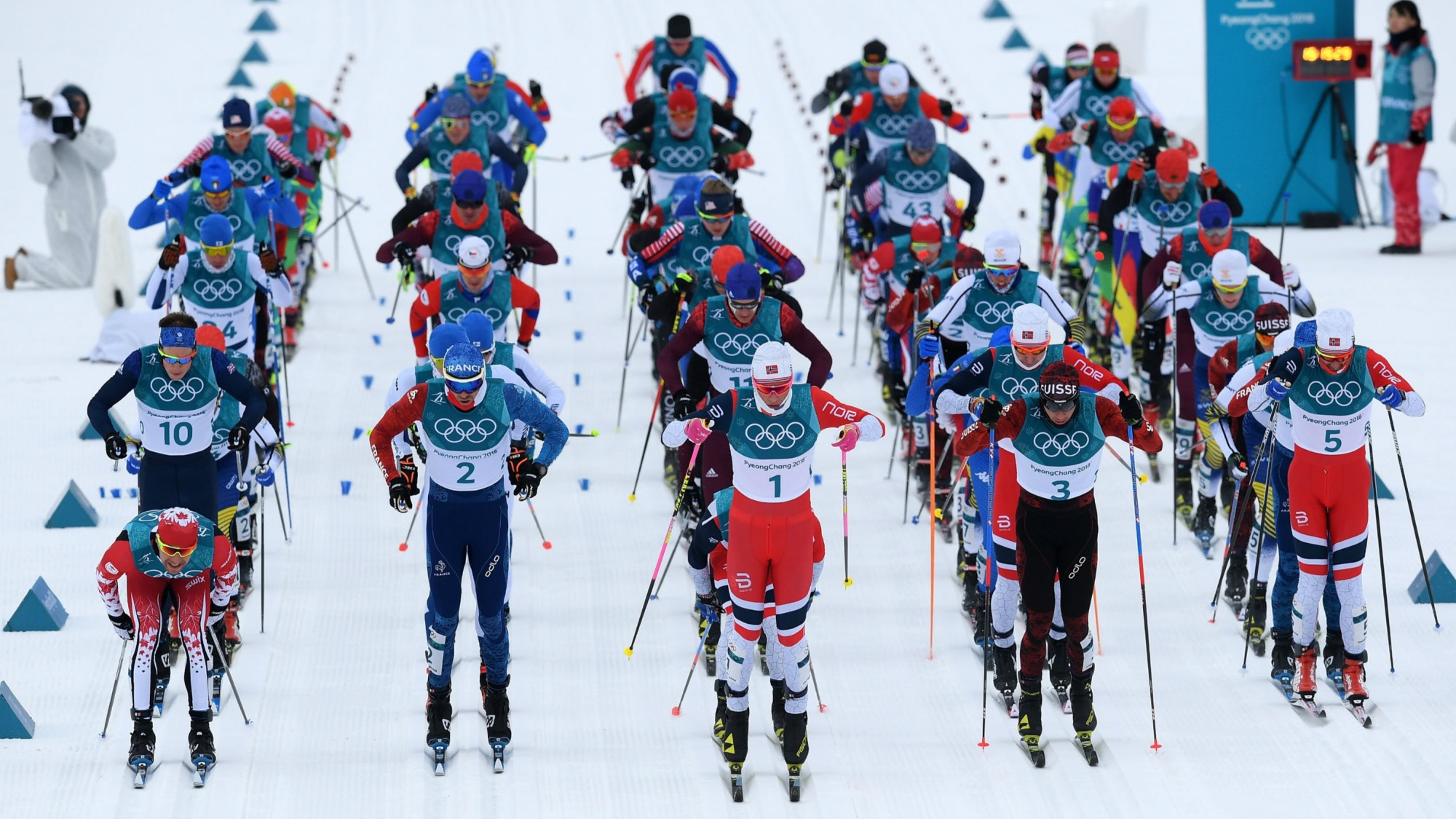 Olympic cross country skiers taking off