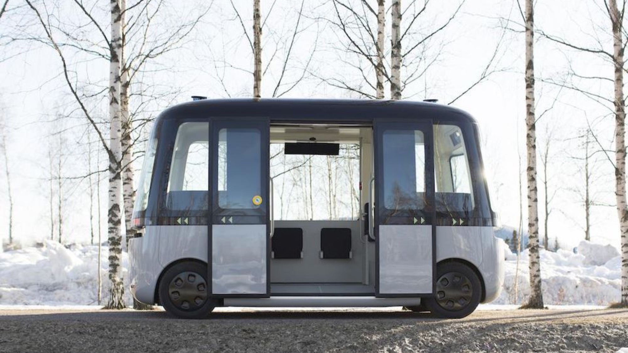 An autonomous shuttle bus with its doors open