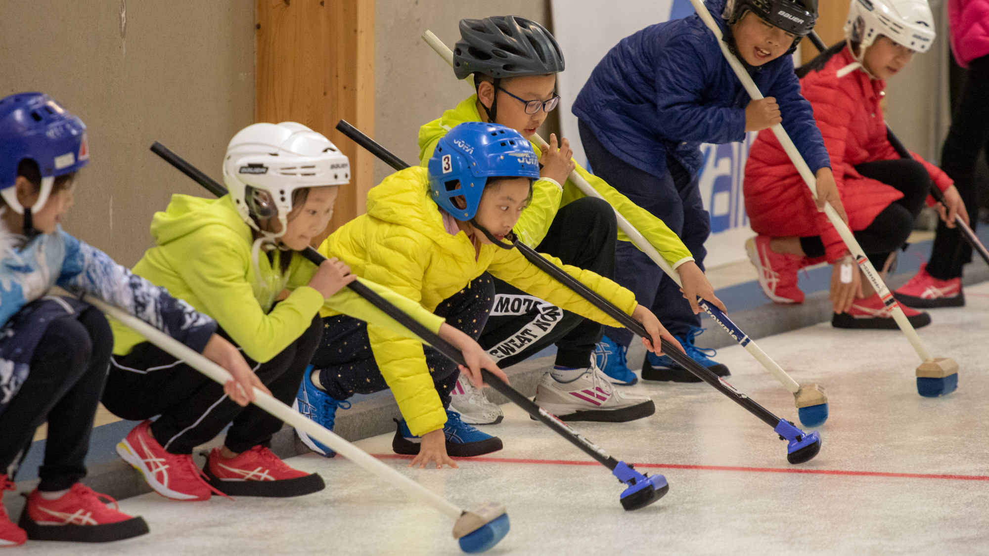 Kisakallio teaches Olympic winter sports to Chinese students. Here they get a taste of curling.