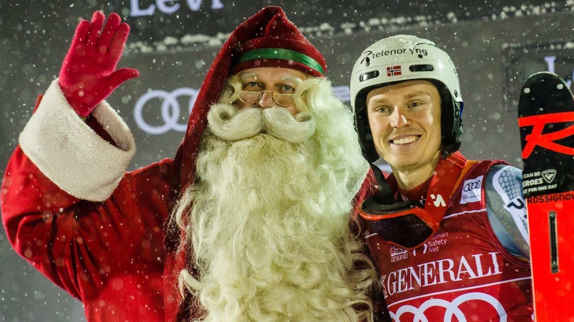 Father christmas and a winter sports athelte