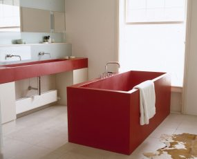 A red bathtub in a red bathroom