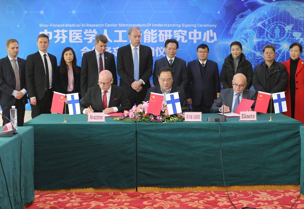 Business people sign an agreement