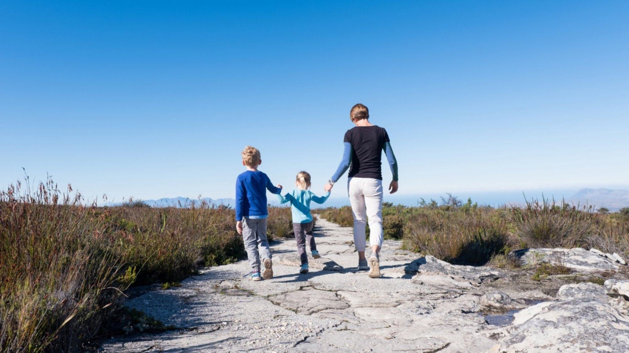 a family walking outdoors