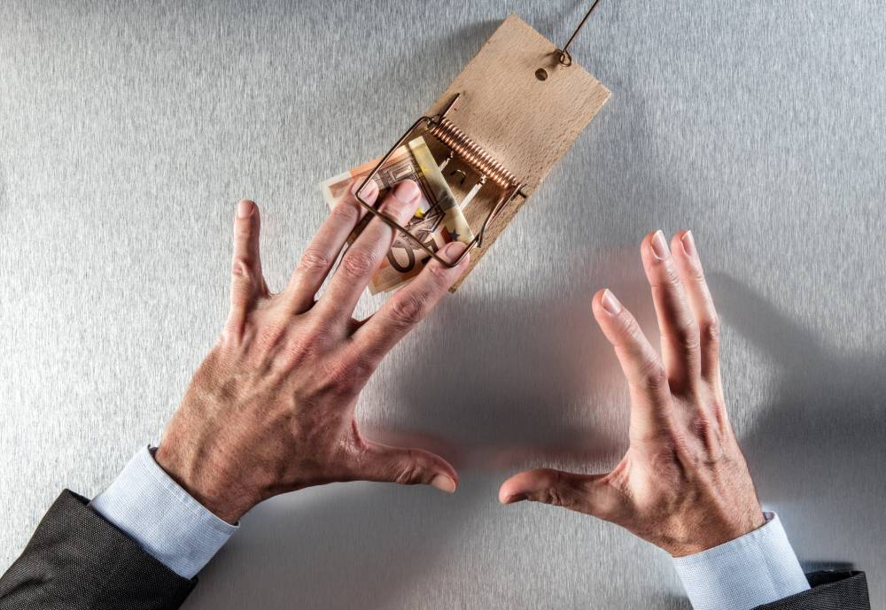 hand caught in a mousetrap