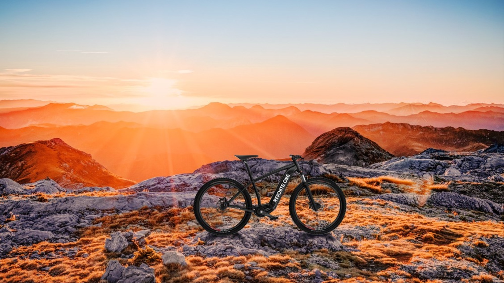A bike standing on a mountain at sunset