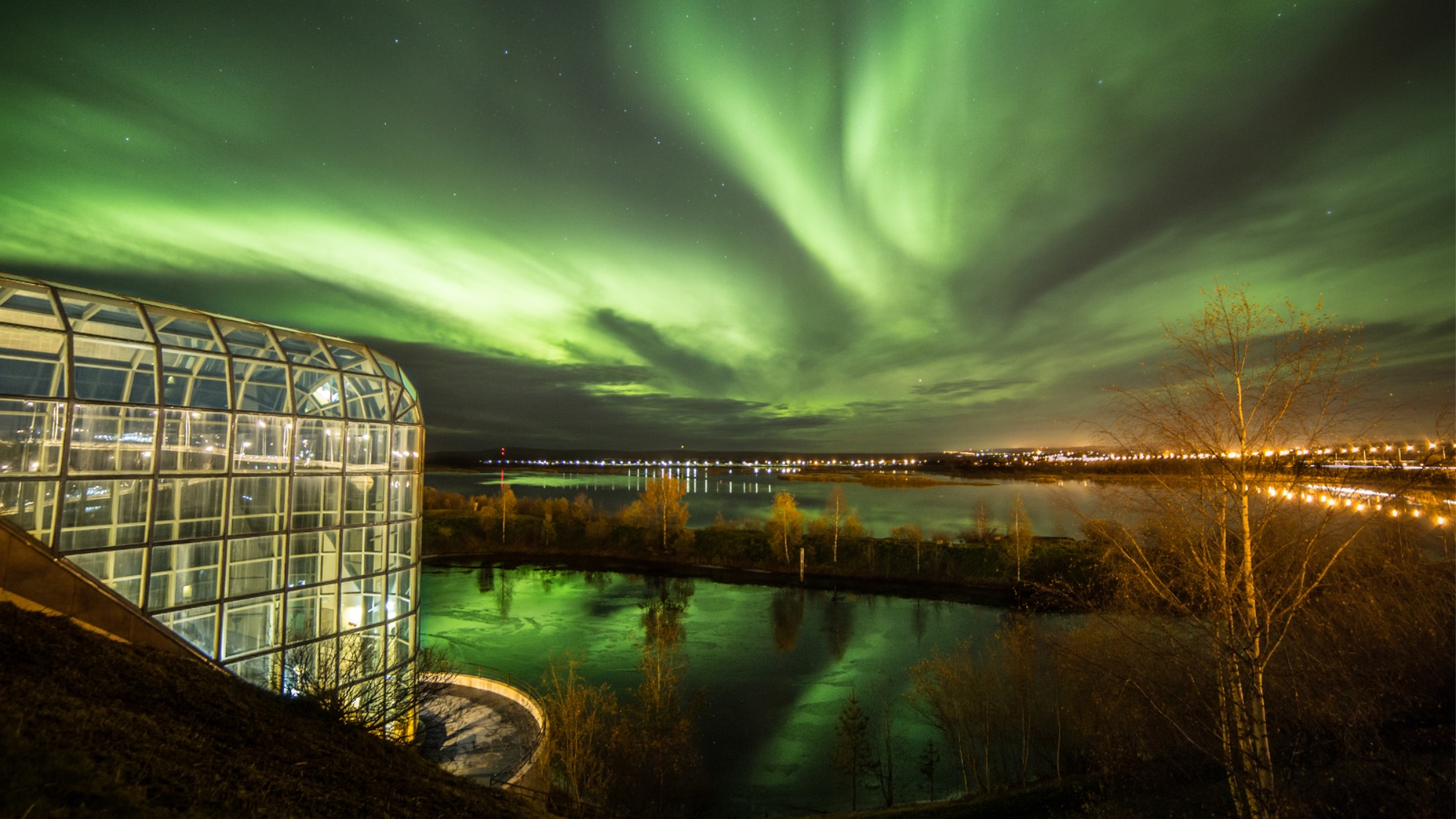 The Arctic Centre in Rovaniemi surrounded by northern lights
