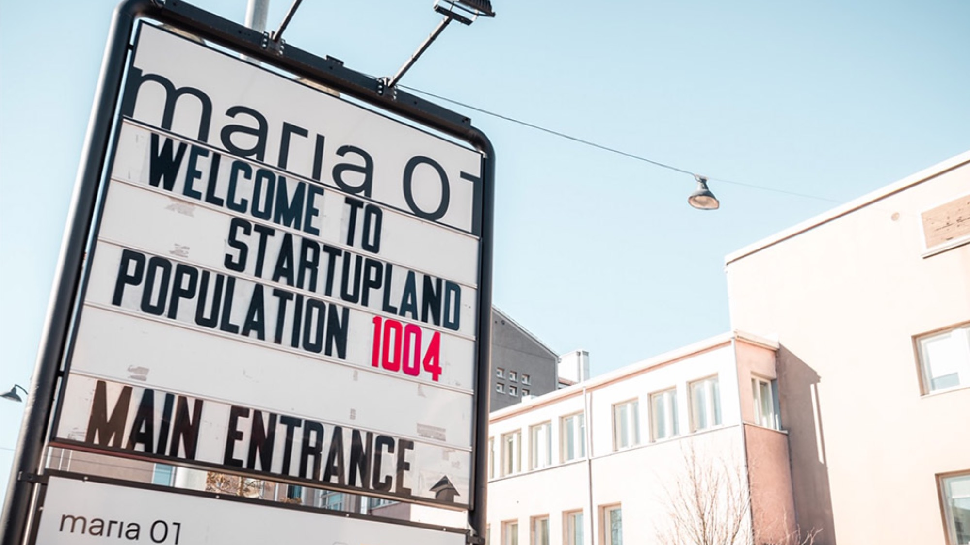 A sign outside the Maria 01 startup campus displaying the number of startup residents